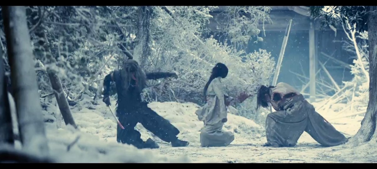 From Warner Bros. Pictures (Japan).  The slaying of Tomoe that occurred years before the events that the franchise takes place in.  She dies saving Kenshin from a killing blow while also in the path of Kenshin's blow.
