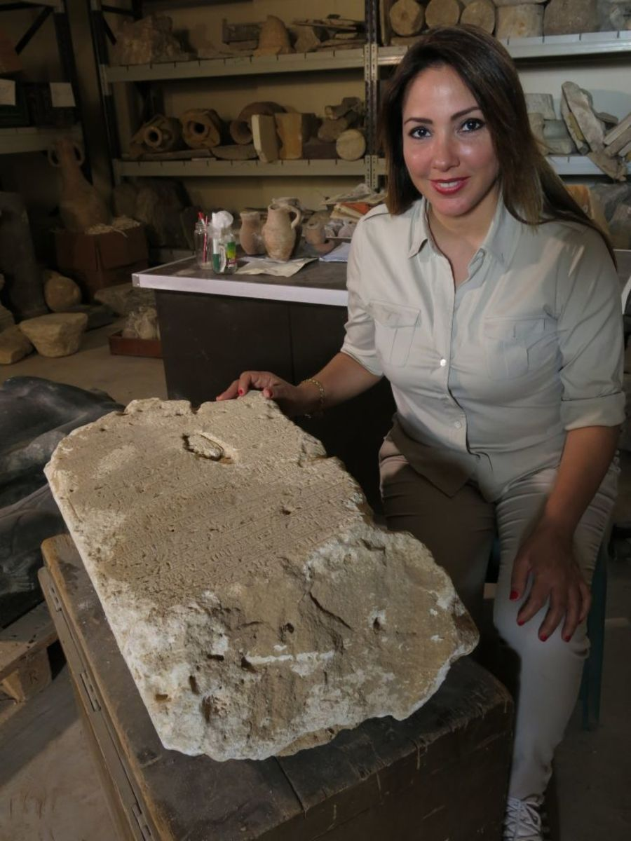 Kathleen Martinez studies an archaeological discovery