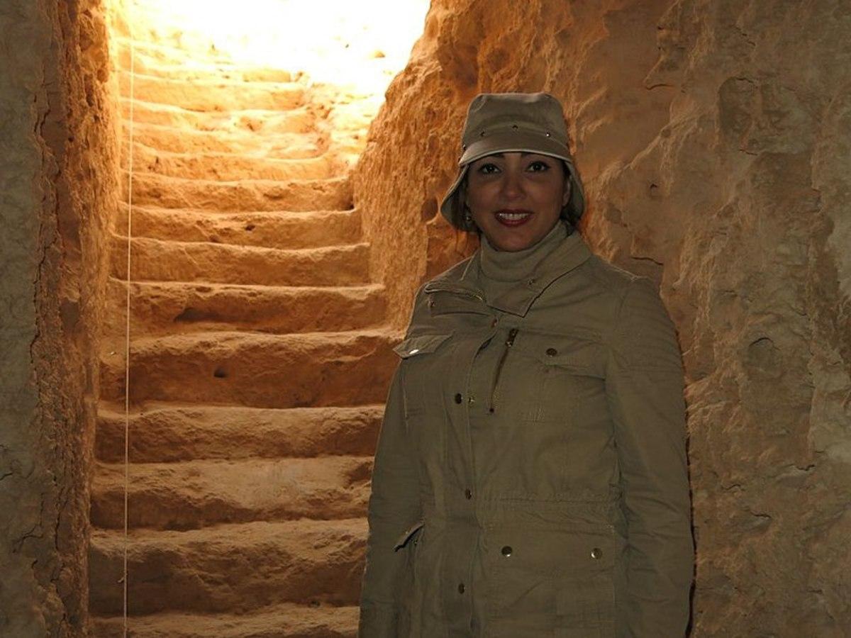 Martinez descends subterranean stairway