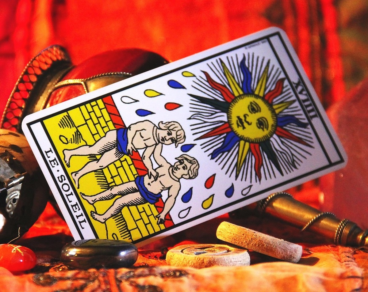 Why is the Sun crying? Is this a good card? Your in-person Tarot reader can answer all the questions a computerized reading will not.
