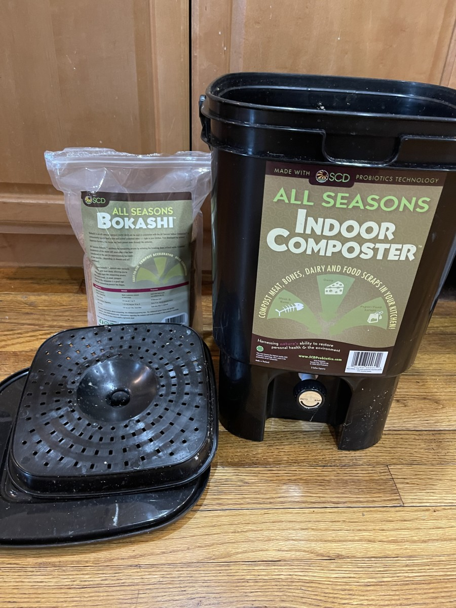 A commercially-available bokashi bucket indoor composting kit  with bokashi bran.
