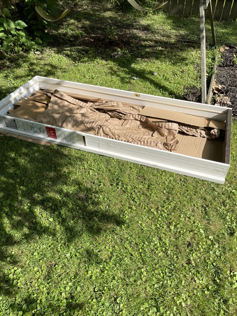 I'm planning on burying my next batch of bokashi pre-compost under this raised bed I have planed for next spring. Yes, this is a raised garden bed frame and not just an old door frame I found in my garage...