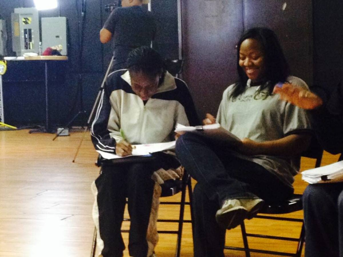 Script working with a staff member while on set.