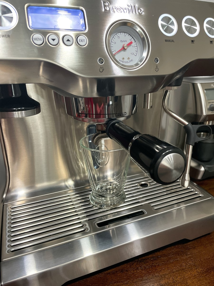 Lock the portafilter to the espresso machine and press the button.