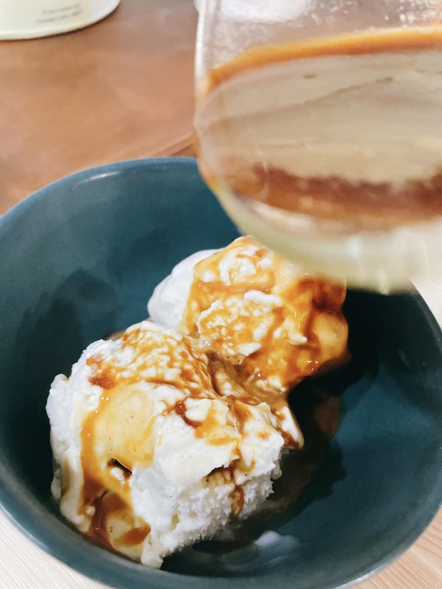Pour the espresso shots over the ice cream.