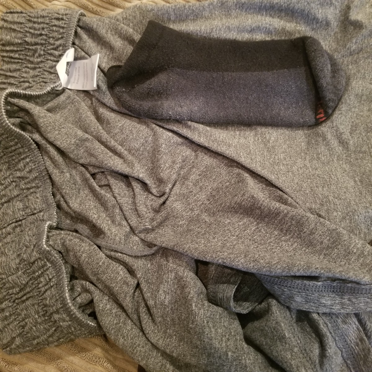 You may find odd socks hidden in large clothing items if you search for them.