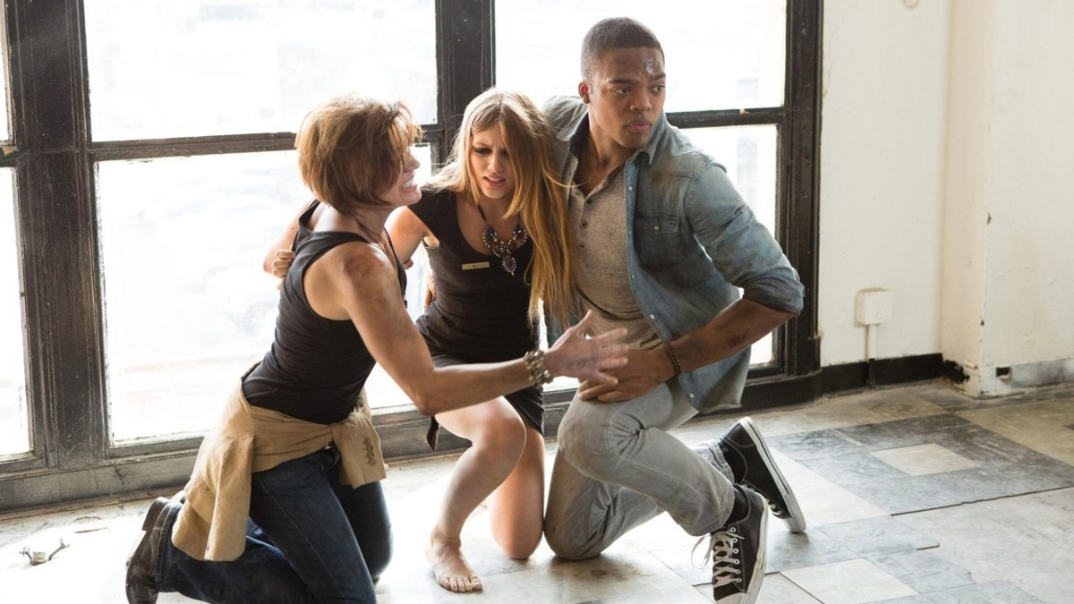 """Outrunning """"the big one"""" are Molly (Jhey Castles) Ali (Grace Van Dien) and Nick (Jason Woods)"""