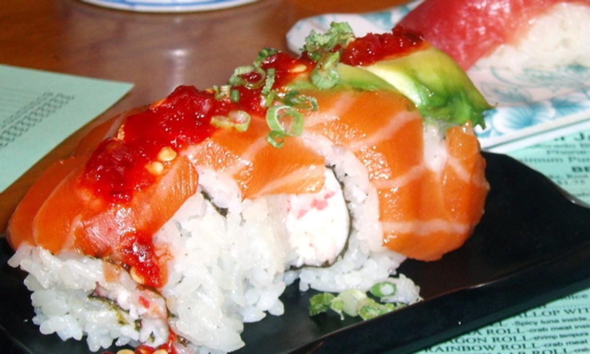 Spicy salmon sushi roll - one of my favorites. Behind it is tuna nigiri sushi.