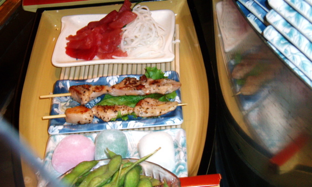 From front to back: Edamame (soybean pods), frozen rice dessert (mochi), a barbecued chicken kebab (yakitori) that I've never tasted, tuna sashimi (another favorite).