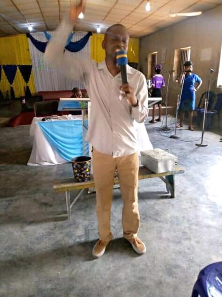 OGUNDARE OLUSEGUN praying with the congregants in a church in Ilorin, Nigeria.
