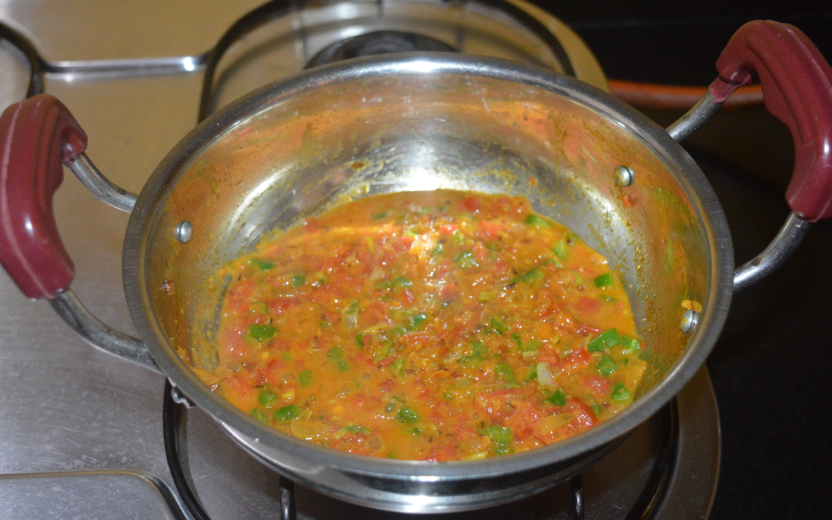 Add a cup of water and allow the mixture to come to a gentle boil.
