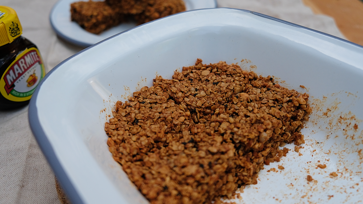 Marmite and peanut flapjack oat bars in the baking tray