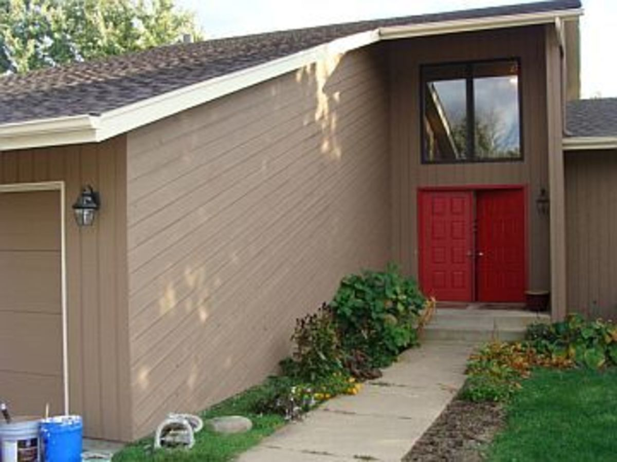 A house with cedar siding I prepped and stained two colors.