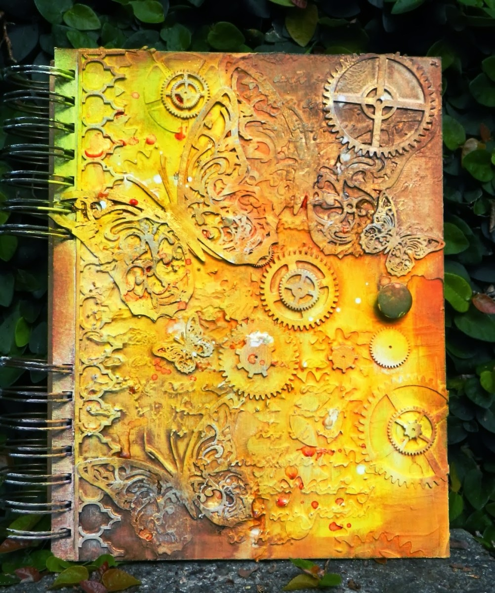 This art journal cover uses paint and chipboard pieces. You cover can be whatever you imagine.