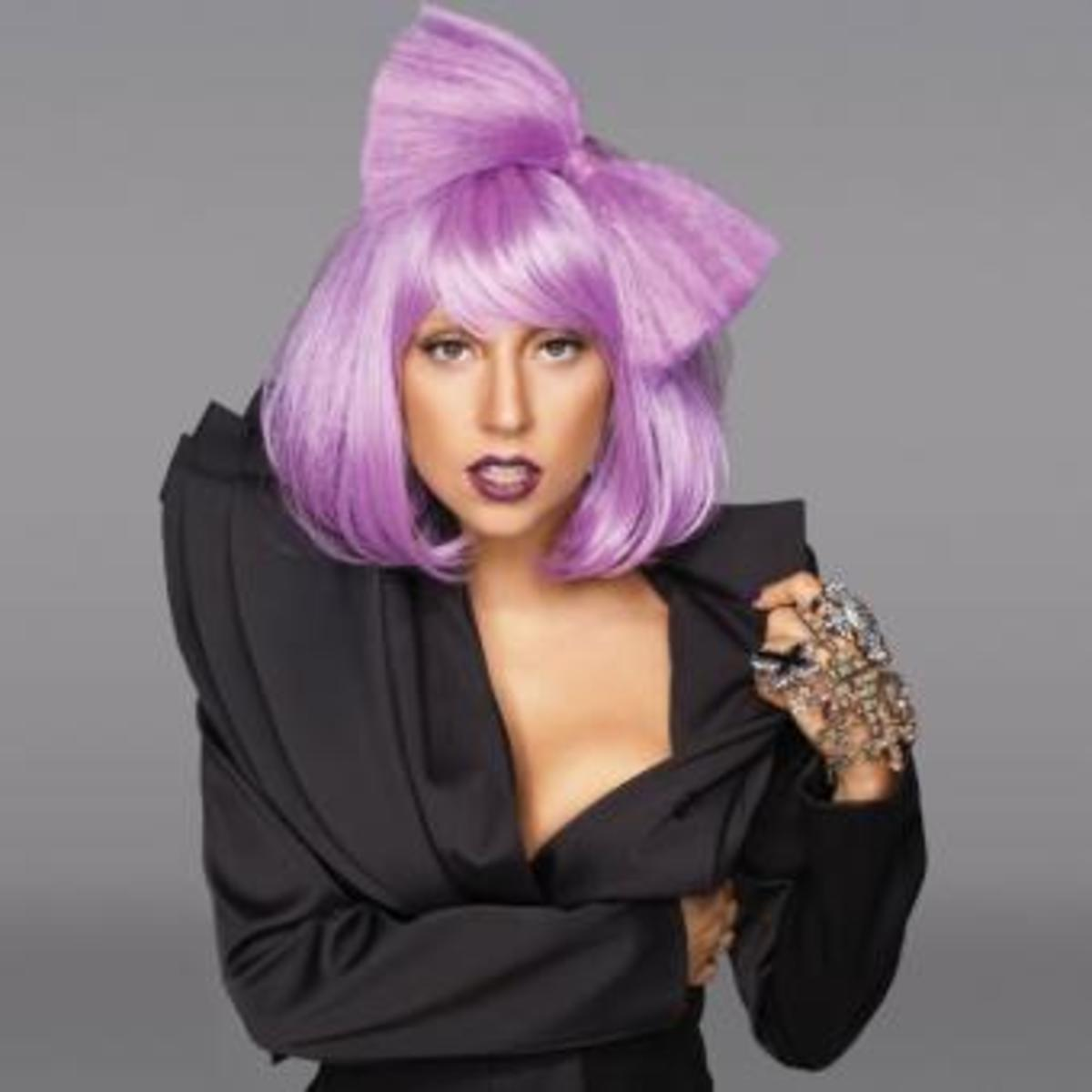 Lady Gaga with purple hair. Wig of bowtie made out of hair. Fun hair color.