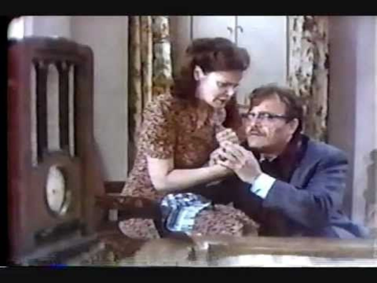 The Muldoon's (Eileen Brennan and Vic Morrow) don't realize that they're listening to is a play