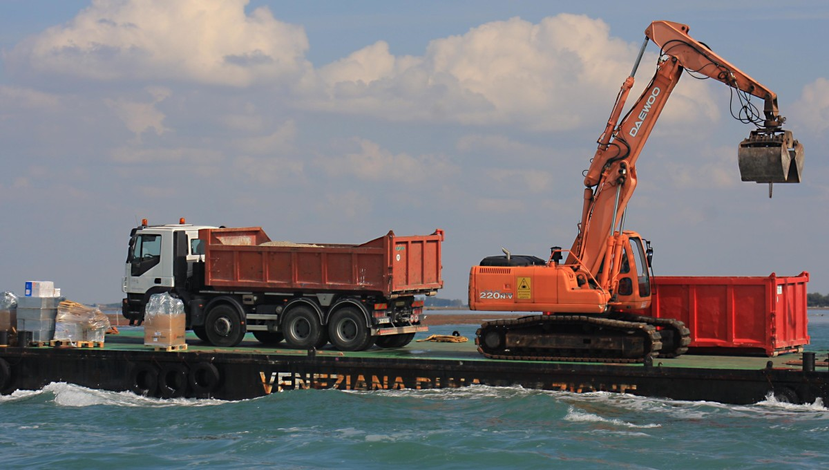 In the Venice lagoon, even trucks and mechanical diggers travel on boats