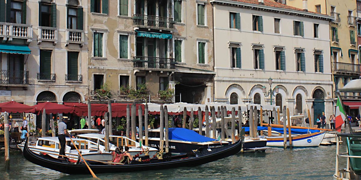 Boats on the water and historic buildings along the banks of the Grand Canal