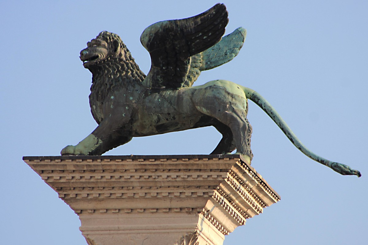 The winged lion or 'chimera' atop one of the two columns in the Piazzetta San Marco