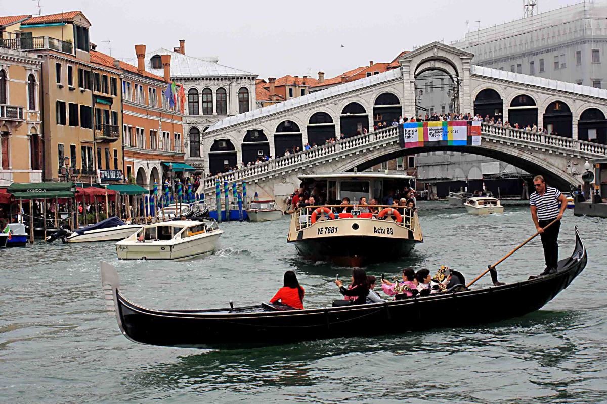 The Rialto Bridge and the quintessential image of Venice - a gondola on the Grand Canal. Looking at this photo, one wonders why there aren't more boating accidents on the canal?
