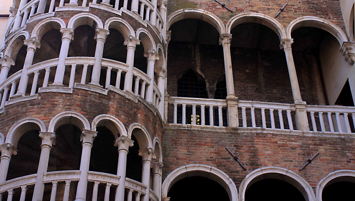 Scala del Bovolo, and the palace it serves. The Palazzo Contarini del Bovolo was built in the 15th century, and its beautiful staircase was added in 1499. 'Bovolo' means snail-shell, referring to the spiral shape and appearance of the staircase