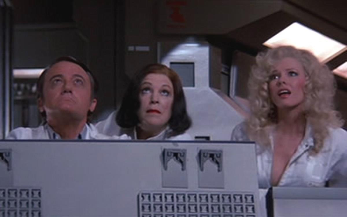 Robert Vaughn, Annie Ross and Pamela Stephenson in Superman III (1983)