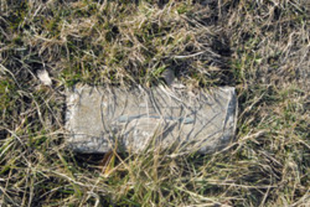 THE SIMPLE STONE THAT MARKS PANZRAM'S GRAVE