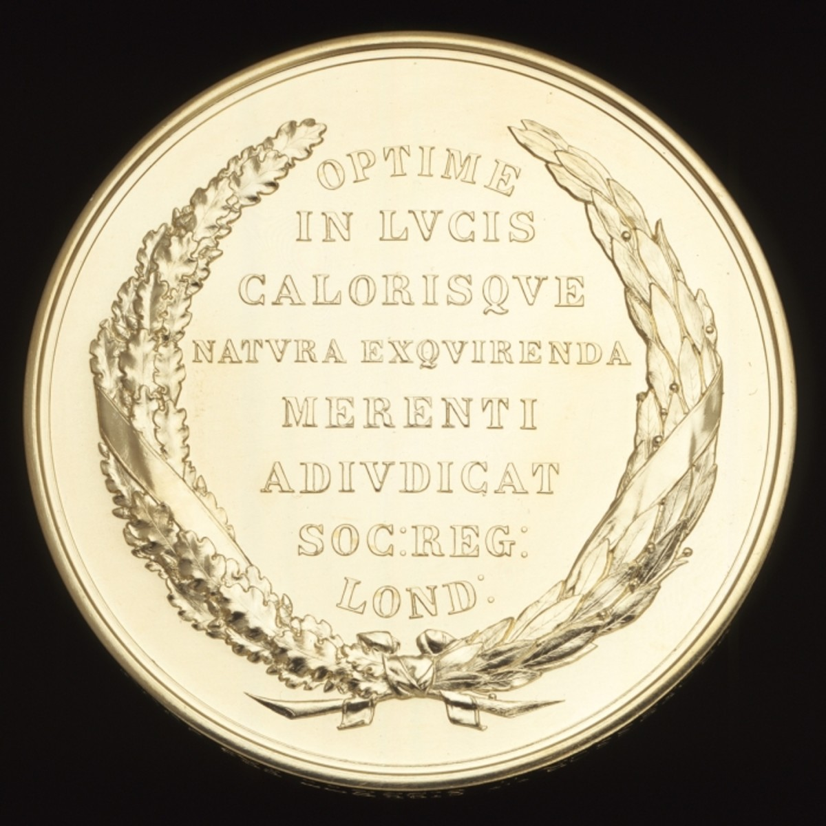 "Rumford medal, reverse.  The inscriptions translates roughly as ""Judged best in the study of the nature of radiant heat by the Royal Society, London."""