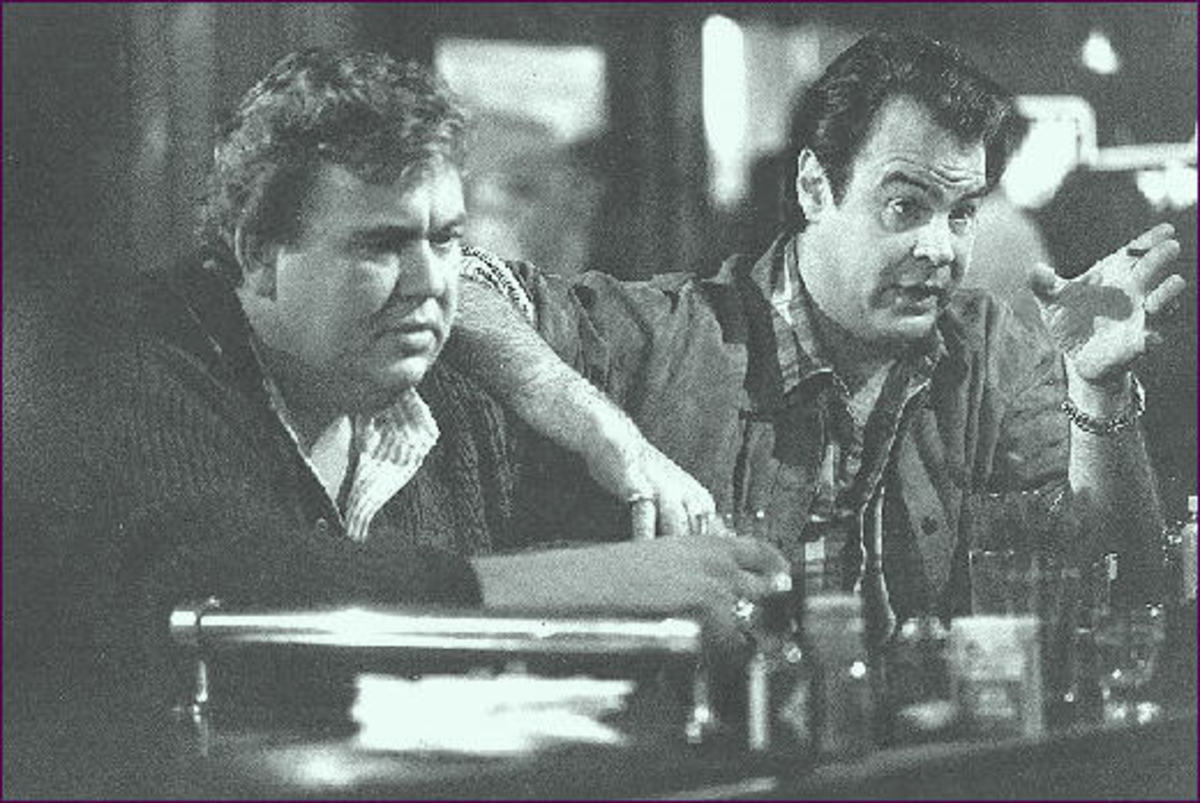John Candy as Chet Ripley (with Dan Akroyd as Roman Craig)