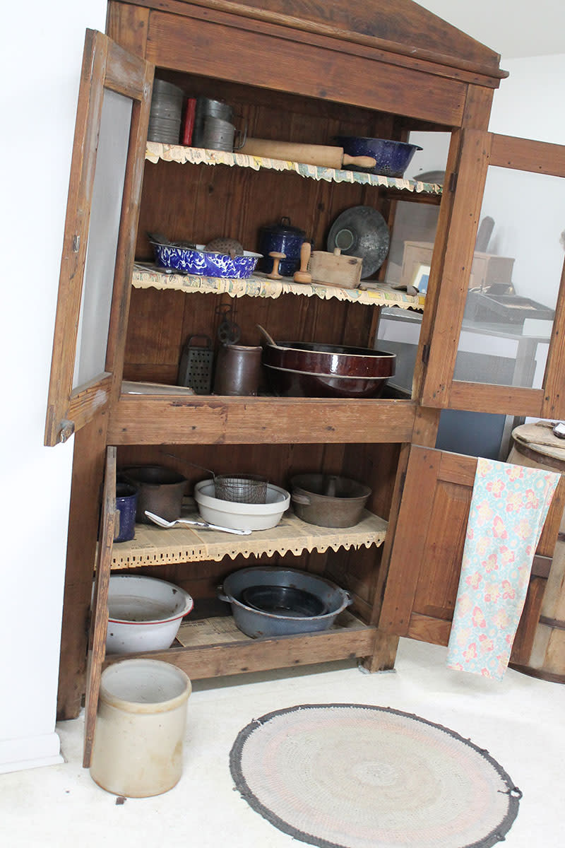 Typical kitchen cupboard used in vintage kitchens.  The screen wire kept flies out of fresh baked pies.