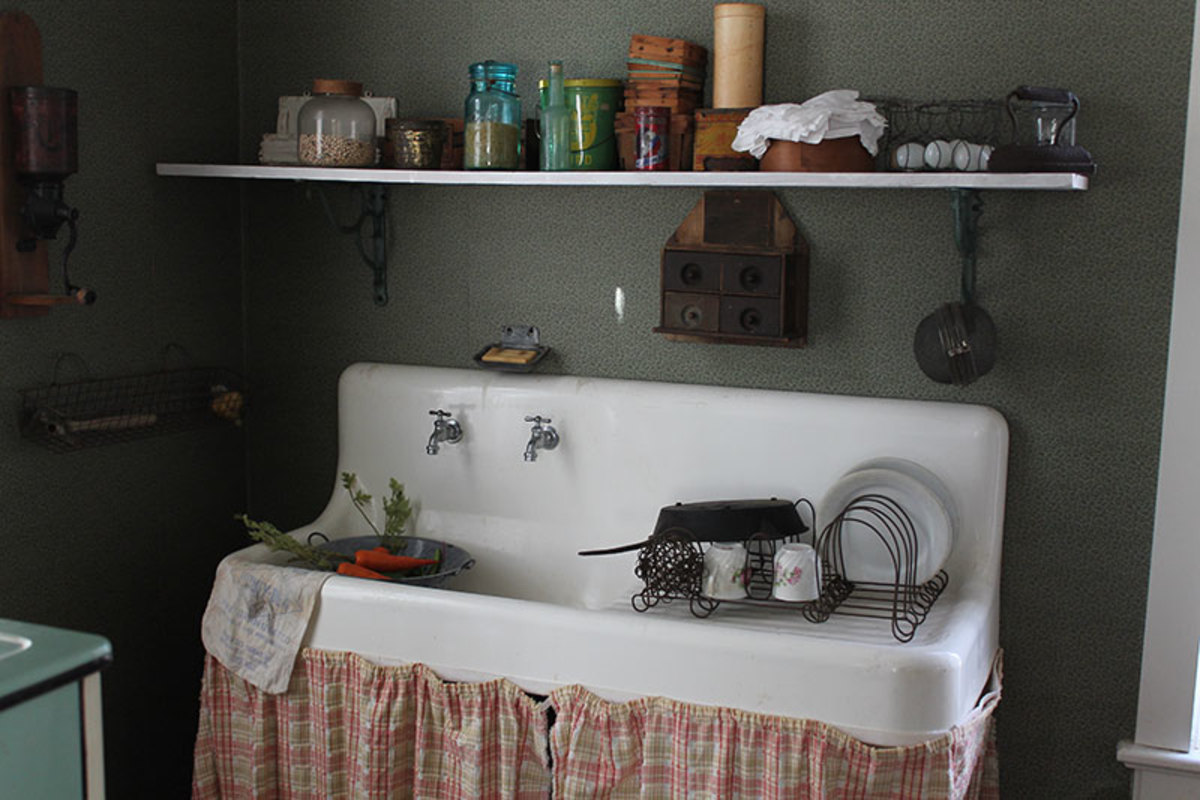 A more modern vintage kitchen with running water.  Most older vintage homes would of had a hand pump pitcher pump for water.
