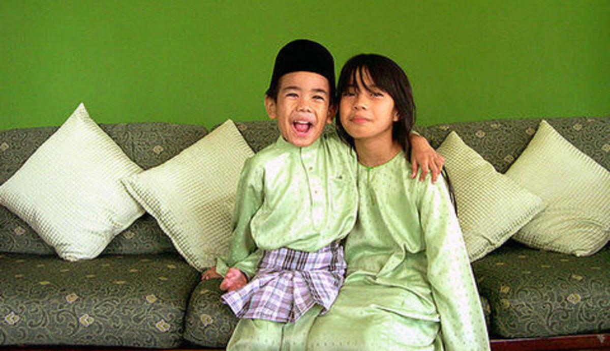 Children in their new traditional Malay baju getting ready for Hari Raya Aidil Fitri celebration