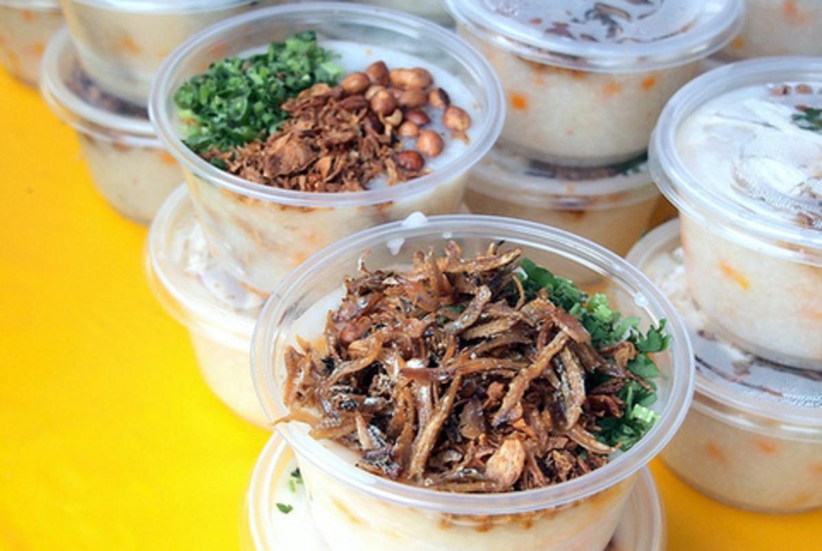 Rice porridge with anchovies, peanuts and coriander leaves, sold at Bazaar Ramadan