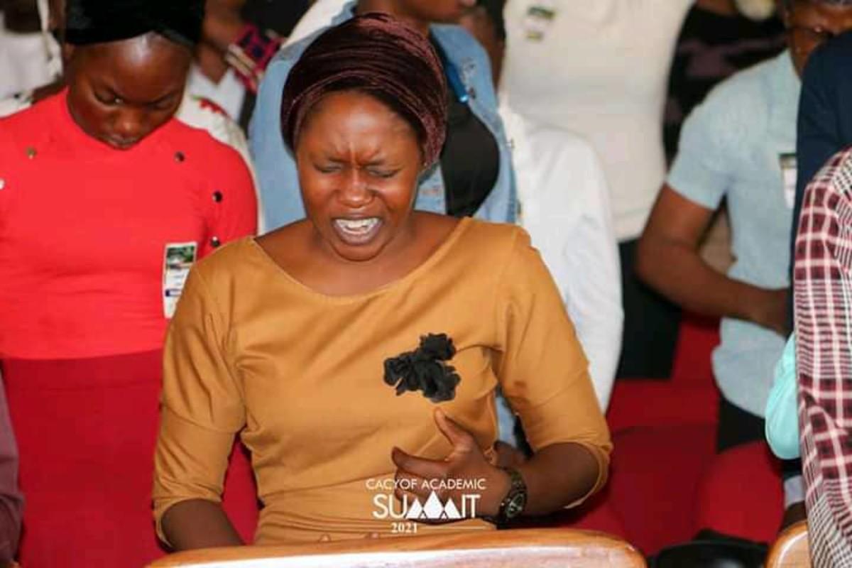 Deborah Oluwaferanmi praying in the midst of the congregation in Ilorin, Nigeria.