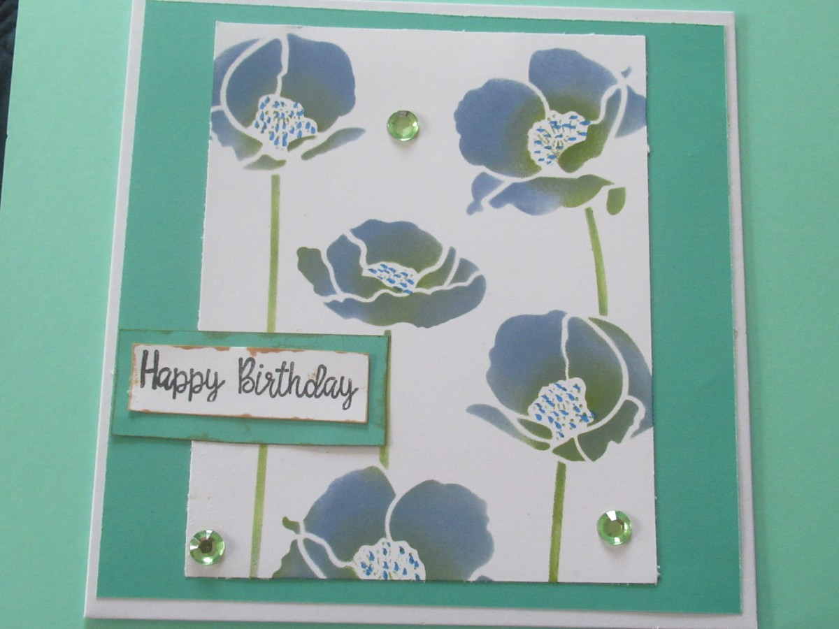 You can use layered stencils as single units to create simple cards that are beautiful on it's own.
