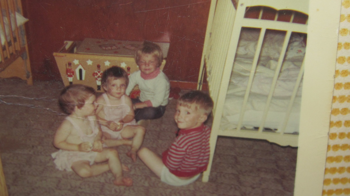Four of Five siblings playing in the twins room.