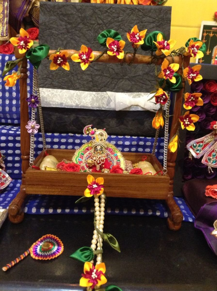 Worshipping Baby Krishna in a Cradle