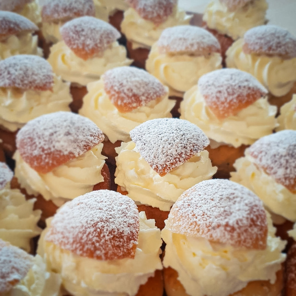 Semlas are buns made from white flour that is a traditional Swedish comfort 'food' invented in 1541. A typical semla is a heavy bun dish covered with cream, chocolates, fruits, and topped with hot milk and raisins.