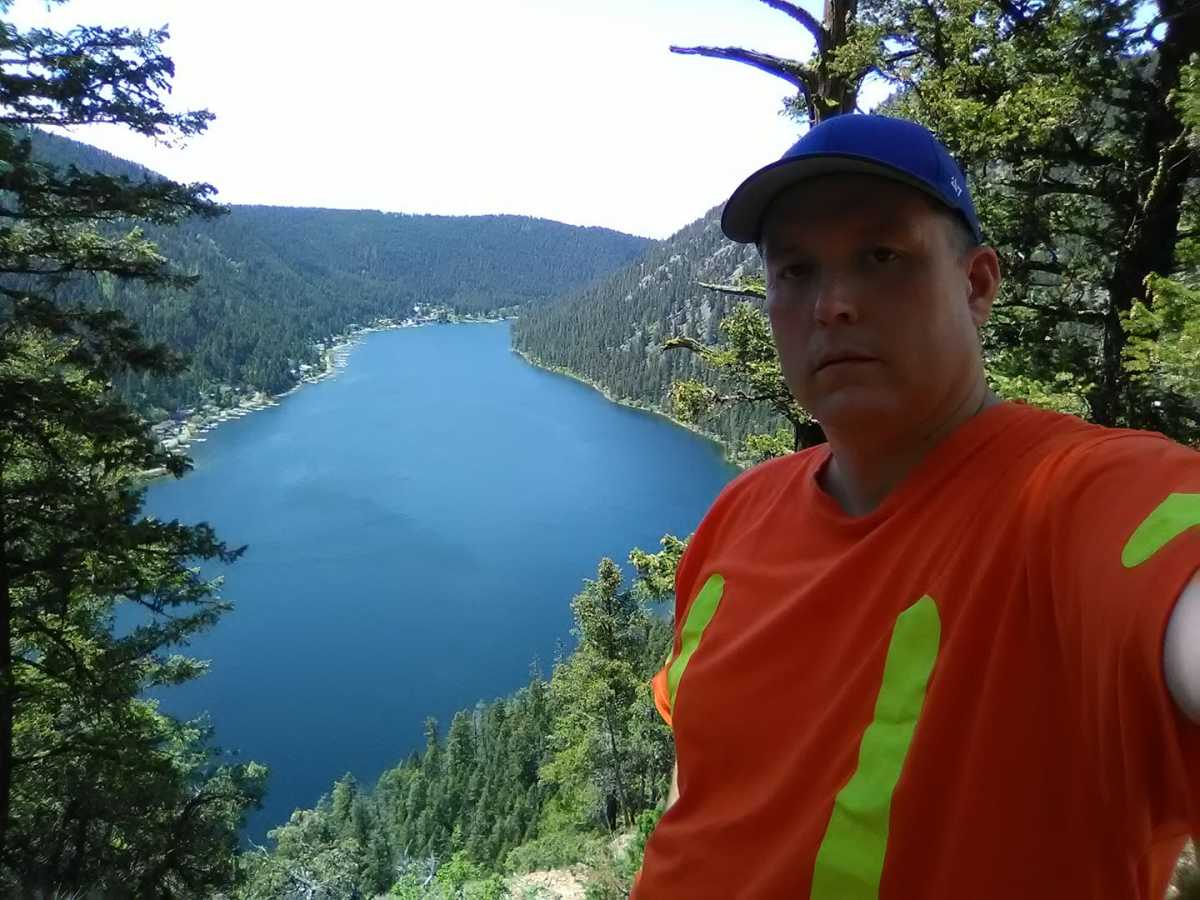 A safety shirt can help you stay visible while hiking in the forest.
