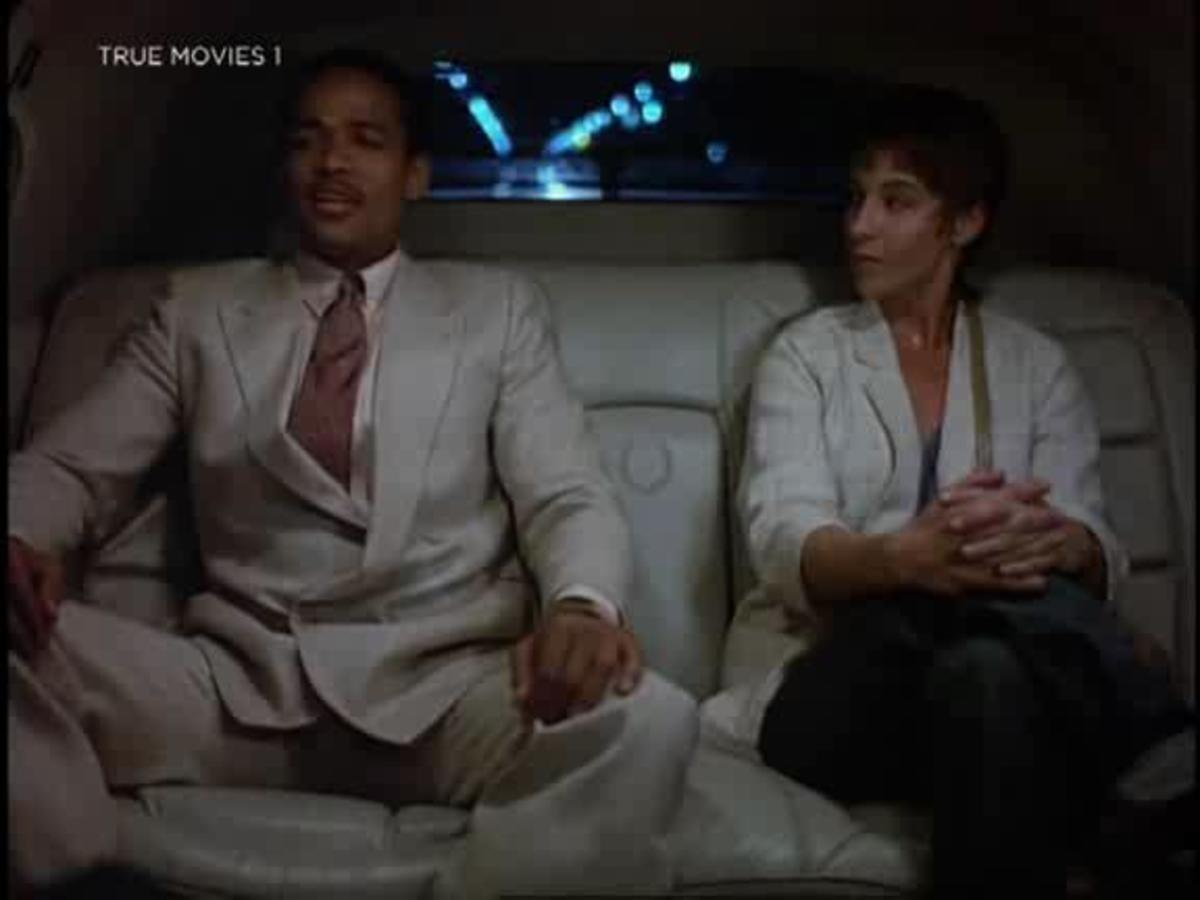 Spanish (Mario Van Peebles) lays down the law to Lois Lee (Kathleen Quinlan) about messing with his girls