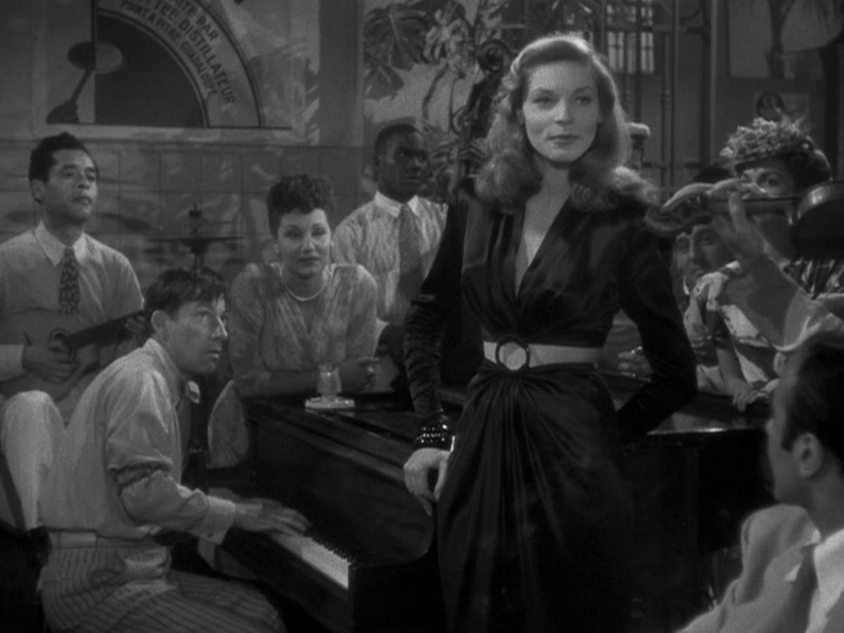 Hoagy Carmichael on piano; Lauren Bacall doing the vocals