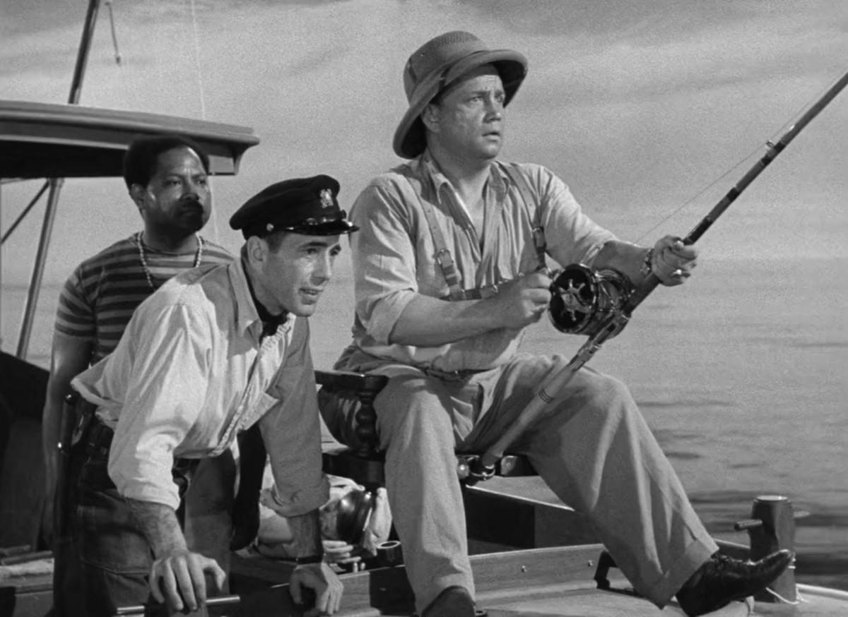 Humphrey Bogart and Walter Sande in front.  Sir Lancelot behind them