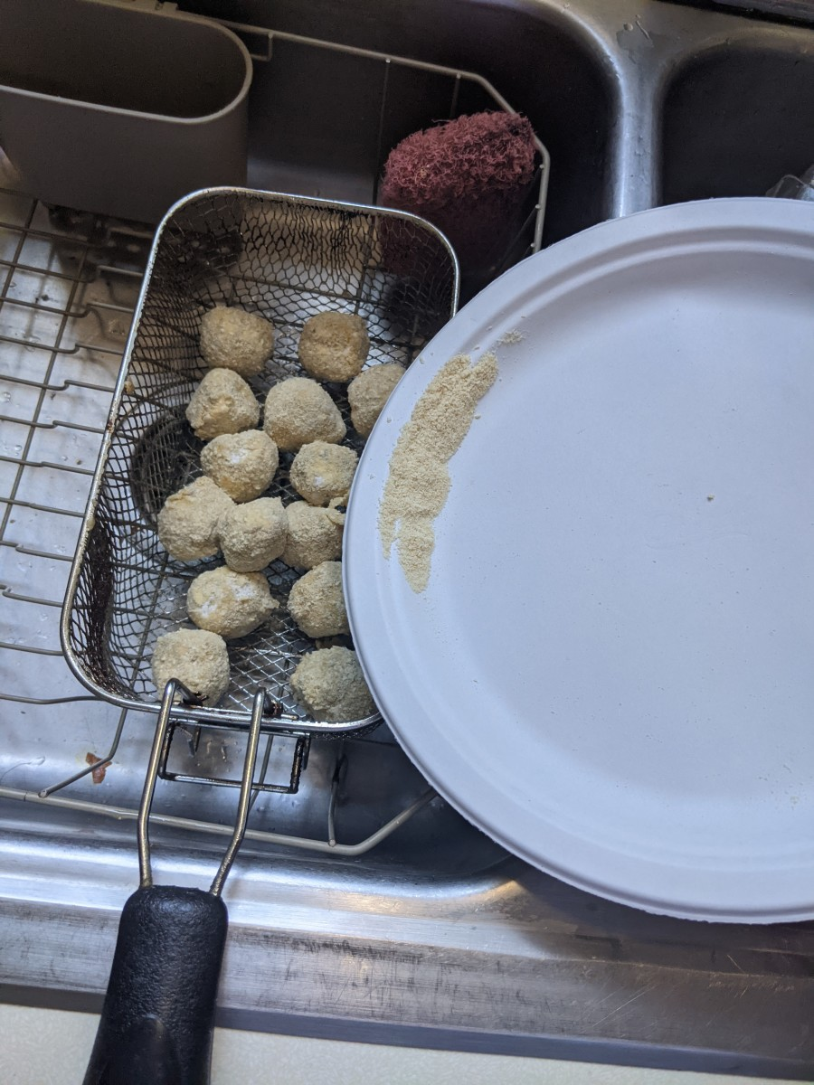 Pour balls into fryer basket over sink to get rid of extra coating