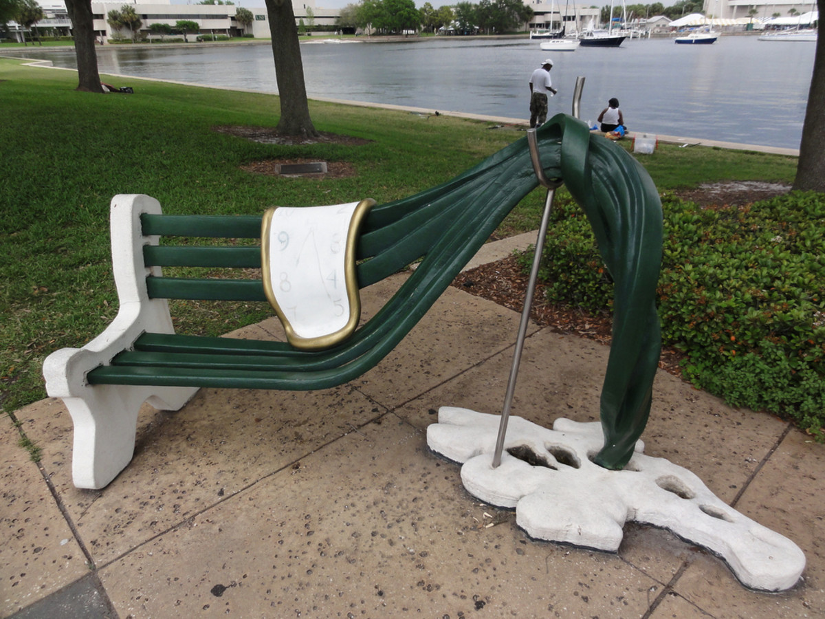 Outdoor work at the St. Petersburg FL Dali Museum. The clock melting on a bench.