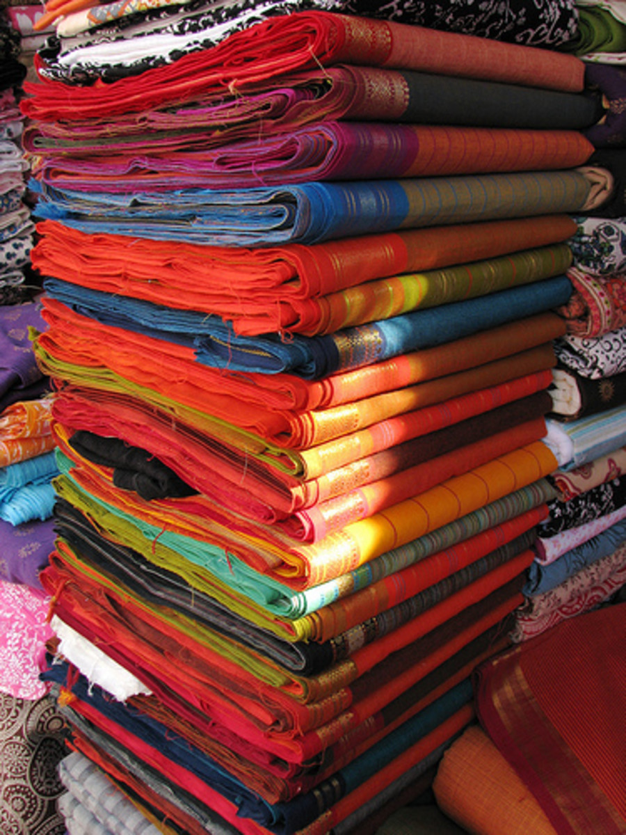 India's woven textiles are famous throughout the world. Delicate colors and distinctive patterns have been hallmarks of the Indian craftsmen for centuries past; the beautiful cotton materials shown above are typical examples. Photo by mckaysavage@fli