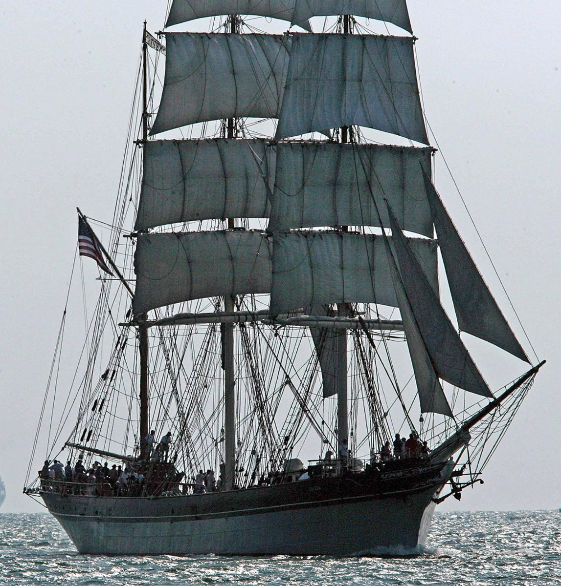 The tall ship Elissa, which has sailed in three centuries, sails up the channel into Port Galveston, Texas.