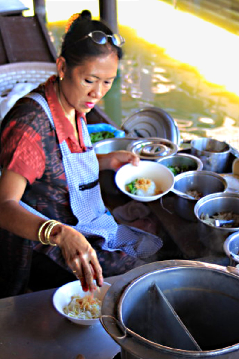 A multitude of pots and pans and bowls. The floating market at the tourist site of Muang Boran has much in common with roadside stalls in the modern city