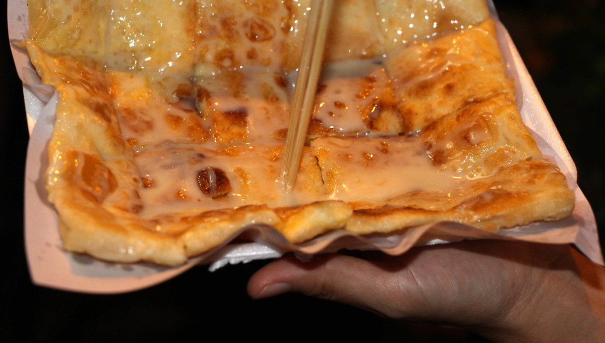 Roti - a take-away flat, pancake-like snack consisting of wheat based dough with banana chunks or banana paste or other fillings