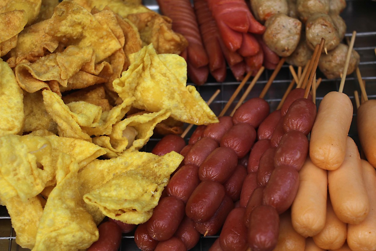 On the left next to the sausage bites are little yellow 'won tons' - triangular dumplings of dough wrapped around pork or fish