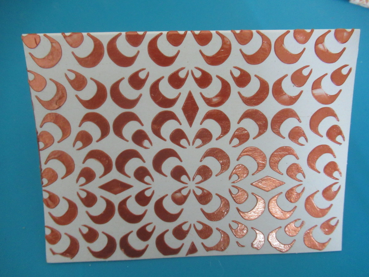 Embossing paste is a medium that anyone can stencil with. It gives you a bright metallic color sesign